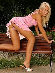 Blonde sweetheart stuffing her red dildo outdoor
